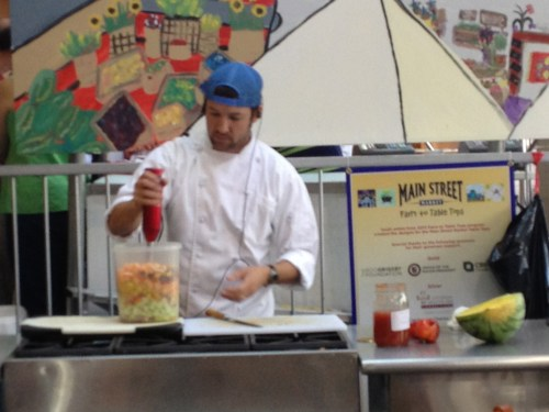 Blending a healthy, colorful gazpacho at the Main Street Market