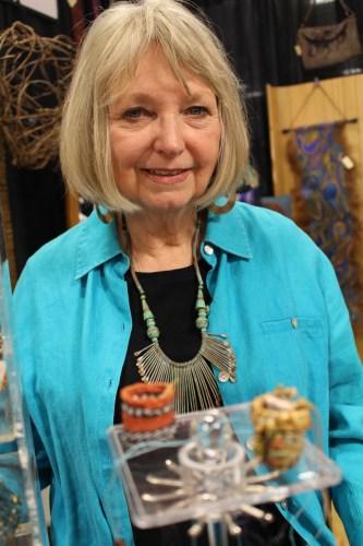 Beryl Lumpkin with her miniature baskets