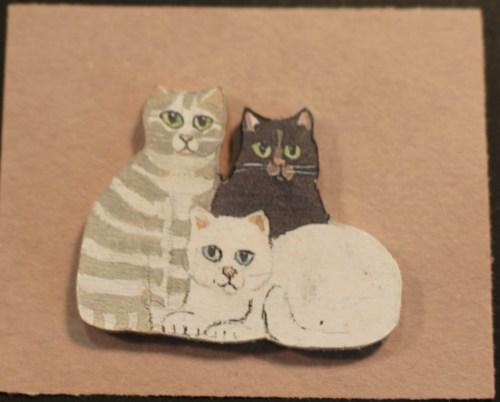 Tiny cat pin by Hugh and Barbara Webb