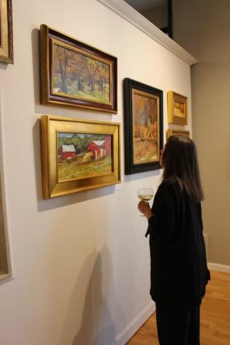 Patron admiring Kathie Odom's art