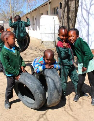 Four kids at recess