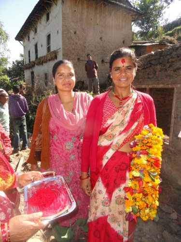 Women of Nepal greeting us on the site of one of our Habitat builds.