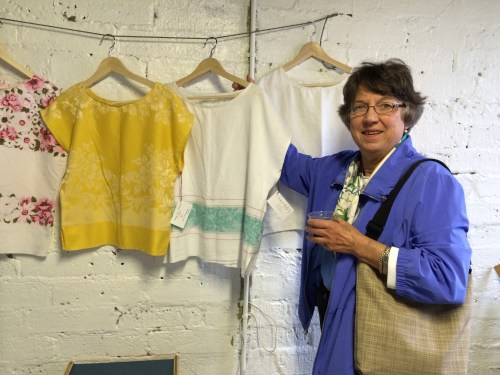 Alix Dempster admires a linen top by Brenna Elrod.