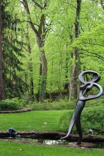 Carefully placed sculpture enhances the natural beauty of Dr. Solomon's gardens
