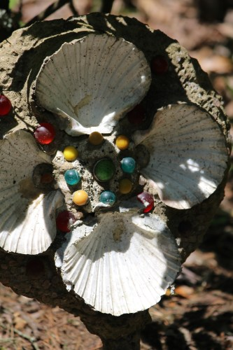 Scallop shells, marbles, and glass