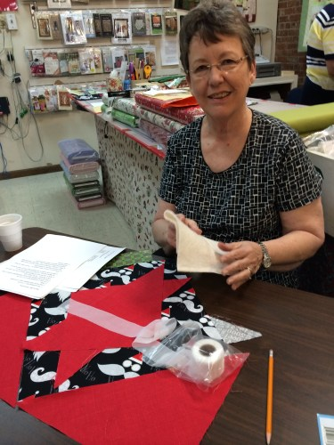 Jane demonstrates how to make a pieced table topper at The Cherry Pit, Sevierville, TN