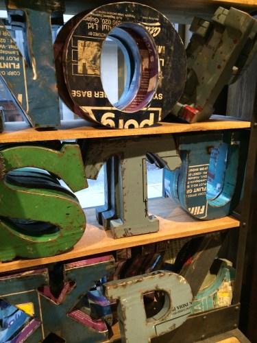 Shelf display of industrial metal letters