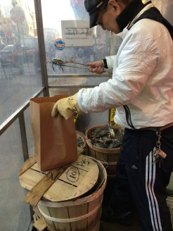 Bagging wiggly crabs one at a time in Chinatown, NYC