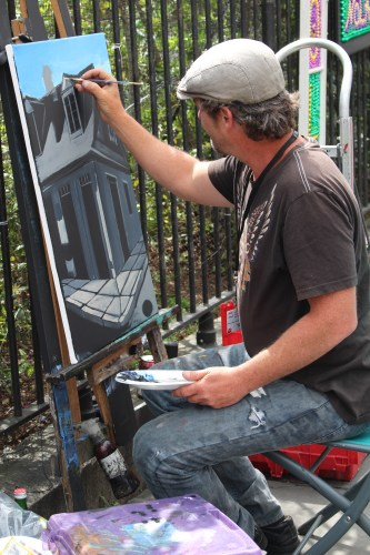 Up early and painting in the cool morning hours -- a street artist near Jackson Square.