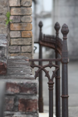 An Ironwork fence curves around this tomb in St. Louis Cemetery 1, New Orleans