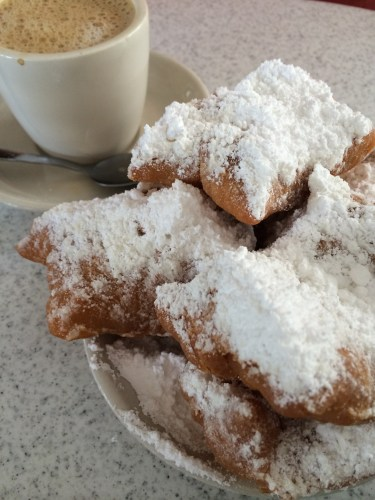 Cafe au lait and beignets at Cafe Du Monde, New Orleans