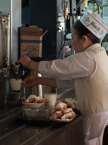 Pouring coffee at Cafe Du Monde