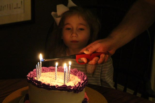 Lighting the candles -- age 7.