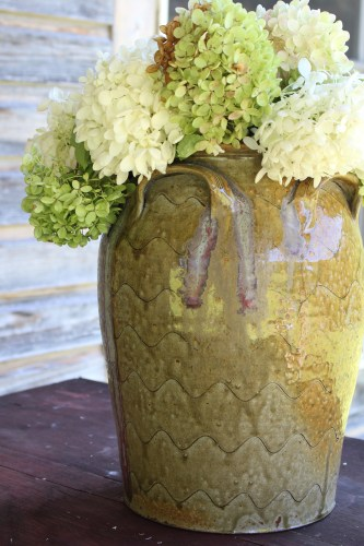 Hand-thrown pottery vase with hydrangeas by Michael Kline., North Carolina potter.