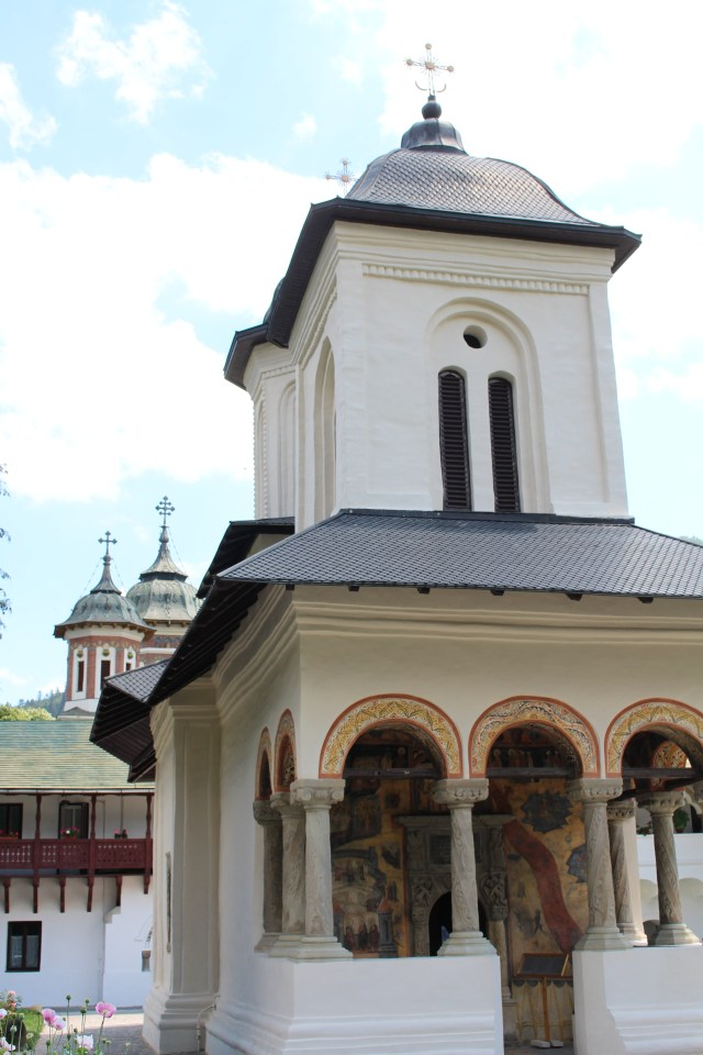 A stately bell tower sits atop Sinai Monastery Old Church in Romania.