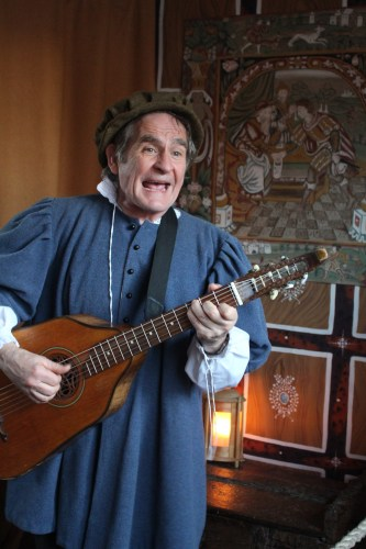 Entertaining visitors with his lute in Shakespeare's Birthplace