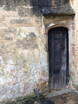 Tiny, tucked-in and very old -- a charming Cotswolds door