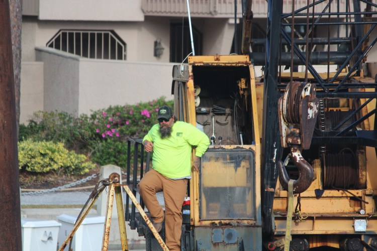 Workers and equipment at Hilton Head harbor