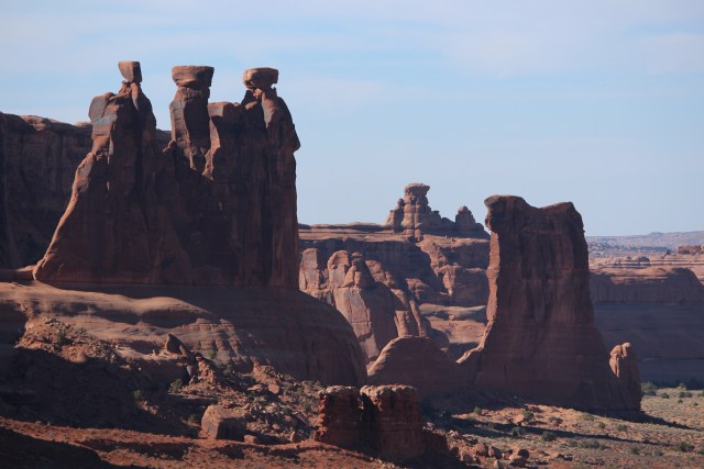A distant, almost haunting view of Three Gossips in Arches National Park.
