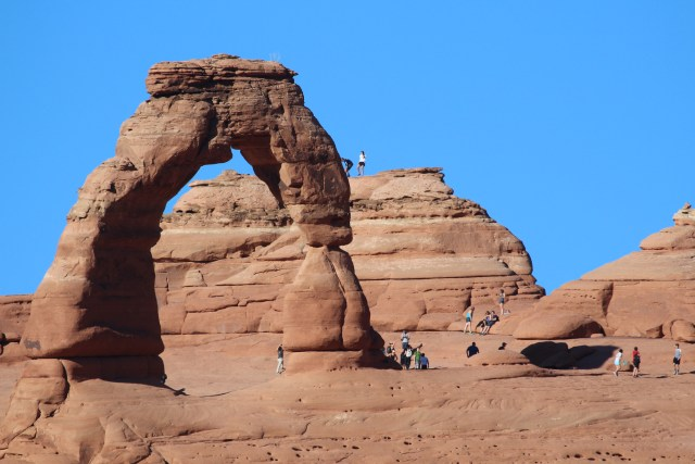 Using a telephoto allows you to see Delicate Arch (and the visitors to the site) in detail.