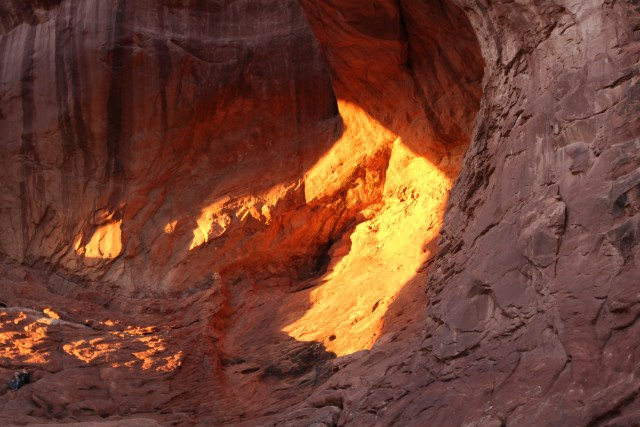 Hikers enjoy the view from the center of Double Arch.
