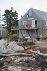 With remnants of the sea in its front yard, this propped up house holds its own near the dock.