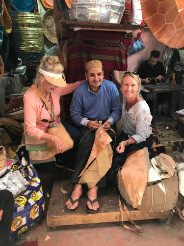 This maker of leather poufs took time to pose with two ladies from California.