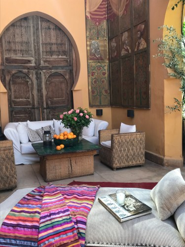 Favorite outdoor lounging area with painted tryptych and carved wood panel.
