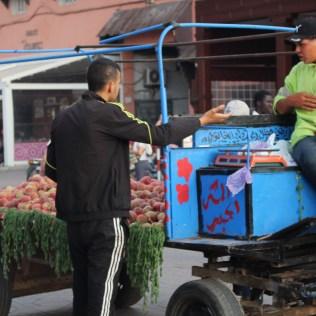 Selling produce in busy Jemaa el-Fnaa