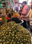 Green and black olives in open bowls: Marrakech medina