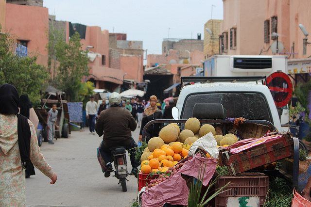 A motorcyclist speeds through the crowds of the Marrakech medina -- and no one seems fazed at all!