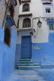 Tile roof above a blue door in Chefchaouen