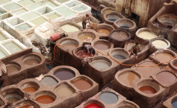 Two parts of a Fez tannery: white side for softening; colored pits for dyeing.
