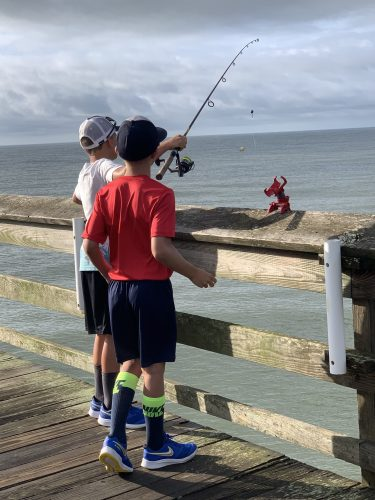 Two boys fishing Pawleys Pier