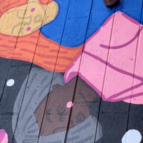 Compassionate women in artist Paris Woodhull's mural for Walls for Women