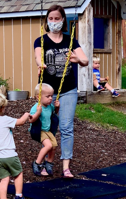 Pre-school teacher in Knoxville, TN caring for kids on playground