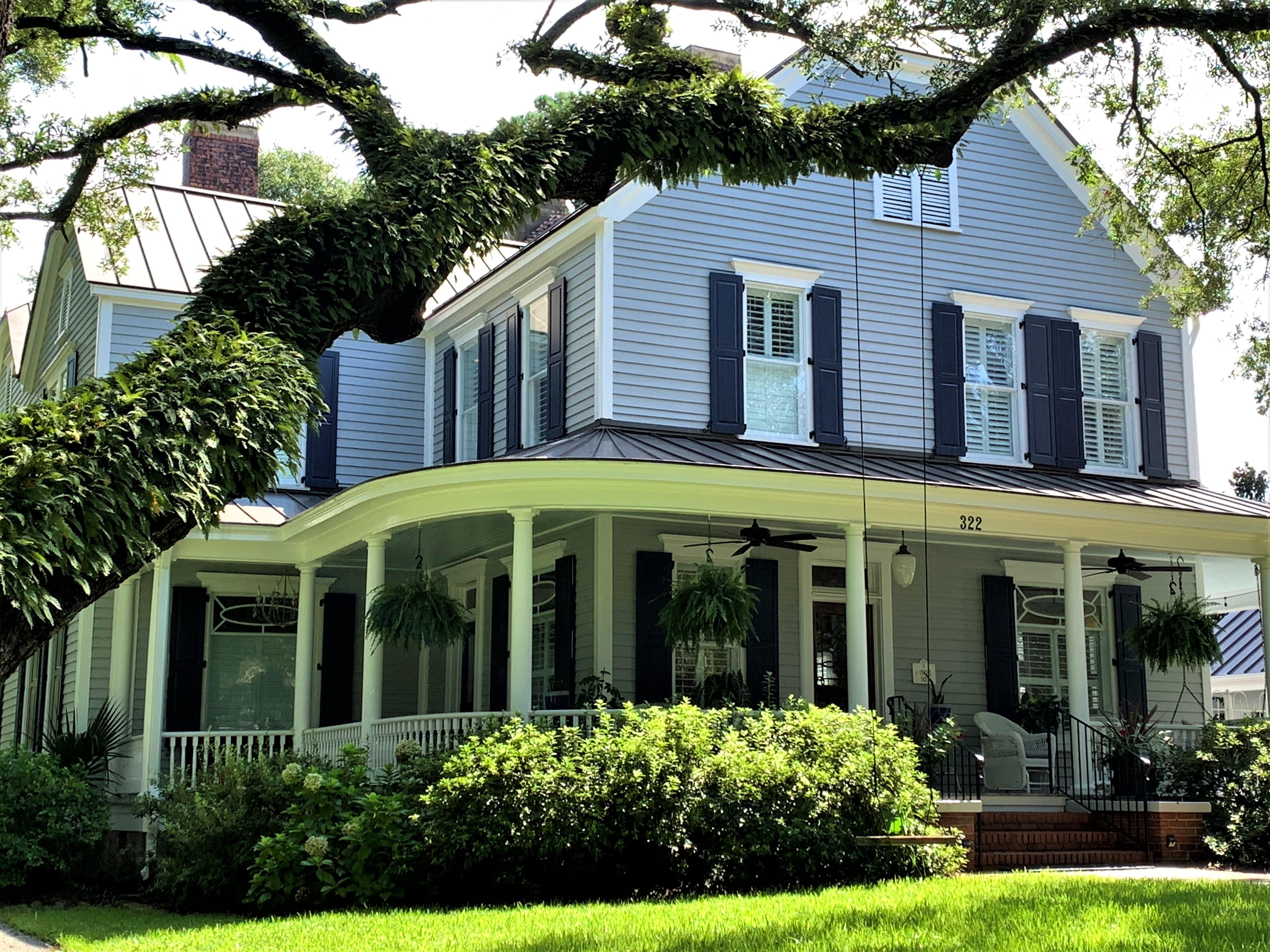 Gray home in Georgetown under live oak tree
