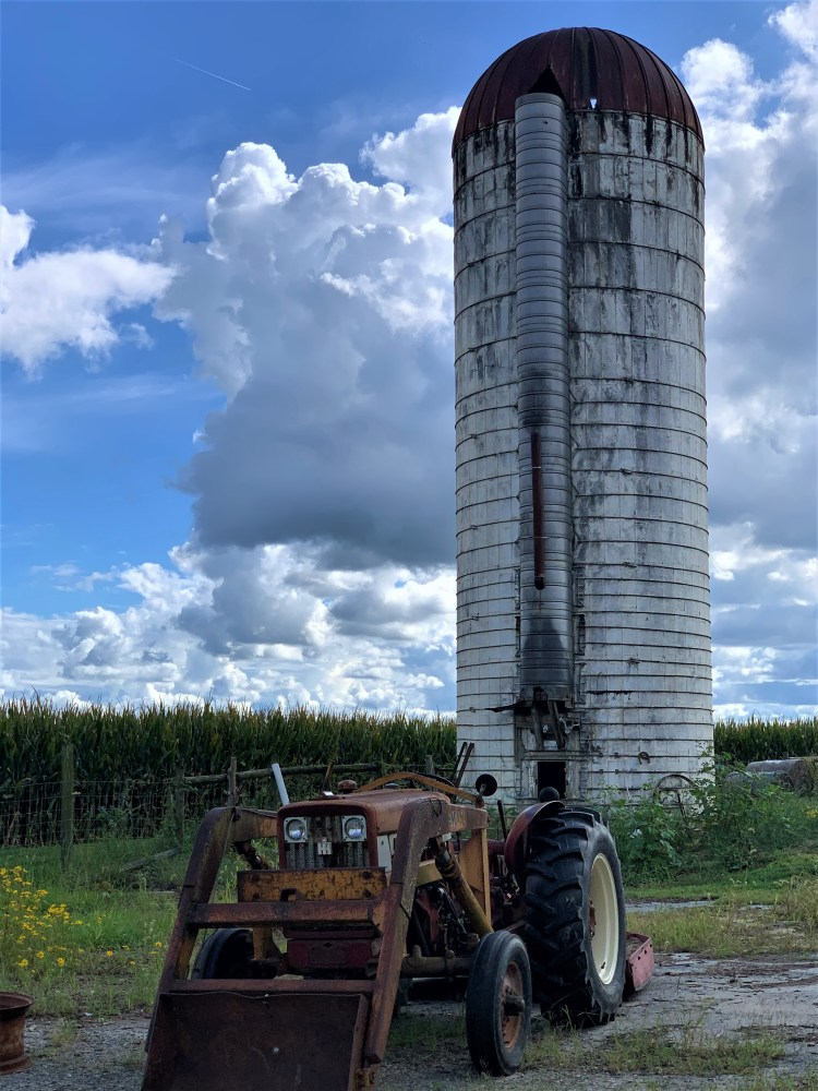 Silo and tractor, Pebble Hall Wildflowers