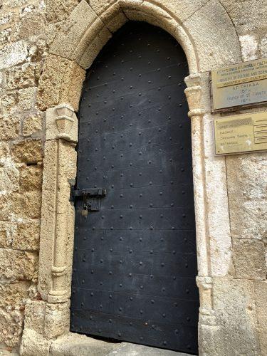Heavy iron door on Street of the Knights