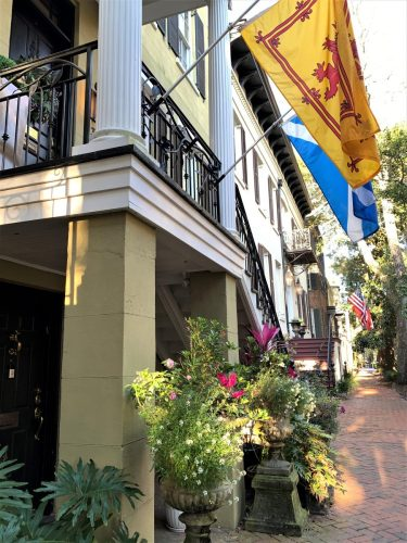 Savannah, GA: Flags, planters, brick sidewalks on Jones St.