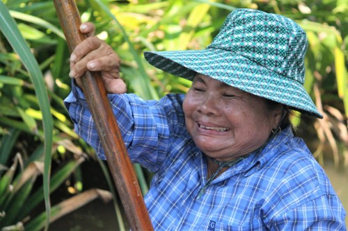 Cambodian woman rowing