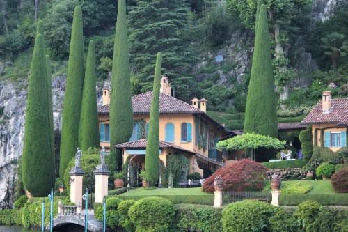 Villa with tall trees, Lake Como, Italy