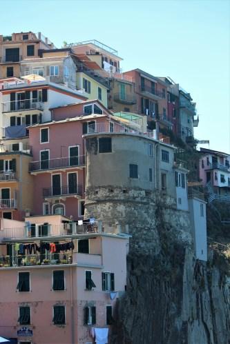 Looking up at houses in Manarola, Cinque Terre, Italy