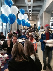Pasta dinner tables marked with blue & white balloons