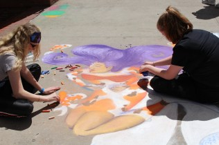 UT Art Education majors creating a watery picture for Chalk Walk 2015.