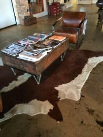 Animal-skin rug, industrial table: Marc Nelson Denim showroom.