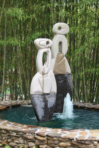 Graceful sculptures among the bamboo.
