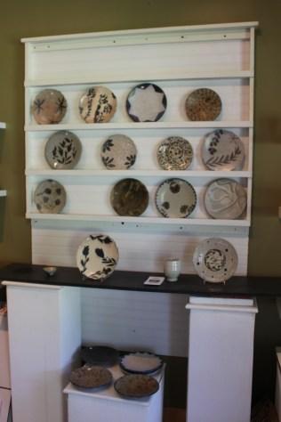 Plates on display inside Kline's workshop