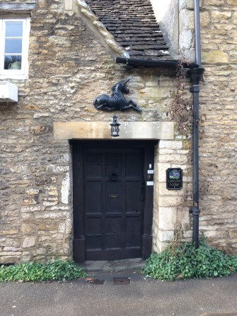 a paneled door on this Cotswolds cottage