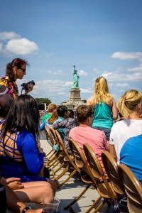 Crowd looking at statue of liberty